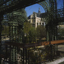 Trellis in a garden in the backyard of a cathedral by Panoramic Images
