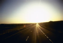 Road passing through a landscape at sunset, Interstate 40, Arizona, USA von Panoramic Images