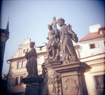 Low angle view of statues, Charles Bridge, Prague, Czech Republic by Panoramic Images