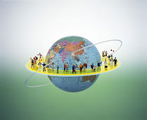Small figures standing on circular yellow catwalk surrounding floating earth by Panoramic Images