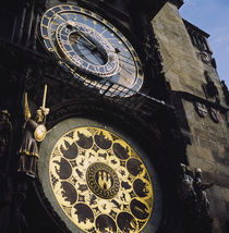Low angle view of an astronomical clock on a government building by Panoramic Images