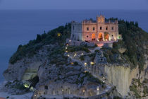 High angle view of a church lit up at dusk on a cliff von Panoramic Images