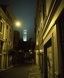 Buildings along a street with a tower in the background von Panoramic Images