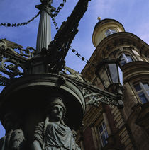 Low angle view of a statue in front of a building, Prague, Czech Republic by Panoramic Images