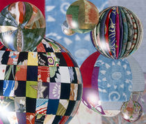 Floating globes filled with reflections of multiple fabric patterns by Panoramic Images