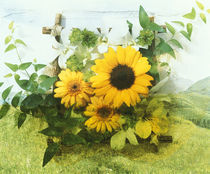 Sun flowers and green vine bouquet with green mountain tops by Panoramic Images
