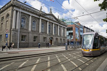 Modern LUAS Tram in front of Iveagh House (Dept of Foreign Affairs) 1730 by Panoramic Images