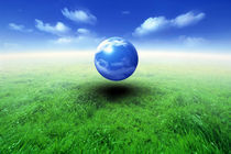 Sphere filled with clouds floating in blue sky and clouds over green grass by Panoramic Images