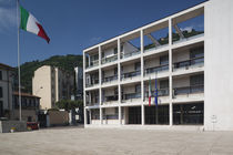 Italian flag in front of a building by Panoramic Images