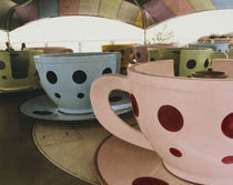 Tea cup ride in an amusement park by Panoramic Images