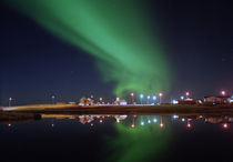 Aurora Borealis over a town, Njardvik, Iceland by Panoramic Images