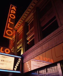 Low angle view of a theatre lit up at night by Panoramic Images