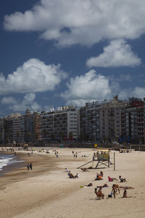 Tourists enjoying on the beach, Playa Pocitos, Pocitos, Montevideo, Uruguay by Panoramic Images