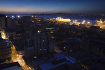 Buildings lit up at dusk, Montevideo, Uruguay by Panoramic Images