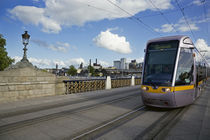 LUAS Tram on the Sean Heuston Bridge, Dublin, Ireland by Panoramic Images