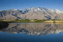 Reflection of mountains in a pond by Panoramic Images