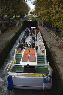 Tourboat in a canal lock, Canal Saint-Martin, Paris, Ile-de-France, France by Panoramic Images