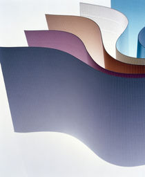 Curved multicolored sheets fanned out on white von Panoramic Images