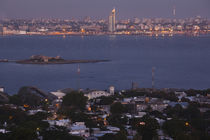 Buildings lit up at dusk, Cerro De Montevideo, Montevideo, Uruguay by Panoramic Images