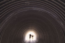 People hiking through underpass, Scotland. von Panoramic Images
