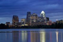 Buildings at the waterfront lit up at dusk, Town Lake, Austin, Texas, USA by Panoramic Images