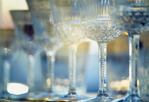 Close-up of wine glasses in a row, Berlin, Germany by Panoramic Images