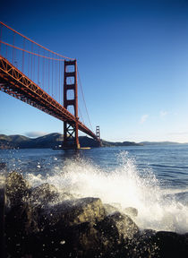 Low angle view of a bridge across the sea by Panoramic Images