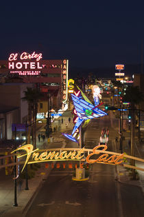 Neon casino signs lit up at dusk by Panoramic Images