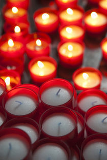 Votive candles in a cathedral by Panoramic Images