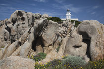 Rock formation with a lighthouse in the background von Panoramic Images