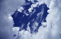 Billowing white clouds, heart shape, blue sky. by Panoramic Images