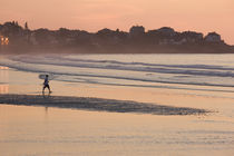 Man walking on the beach by Panoramic Images