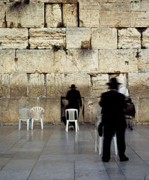 Three men praying in front of a wall, Western Wall, Old City, Jerusalem, Israel von Panoramic Images