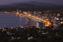 Buildings lit up at dusk, Piriapolis, Maldonado, Uruguay von Panoramic Images