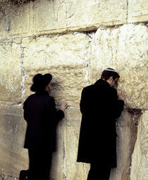 Two men praying in front of a wall, Western Wall, Old City, Jerusalem, Israel by Panoramic Images
