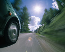 Car moving on the road by Panoramic Images