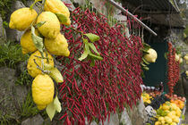 Close-up of lemons and chili peppers in a market stall by Panoramic Images