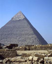 Ruins of a building in front of a pyramid, Great Pyramid, Giza, Egypt by Panoramic Images