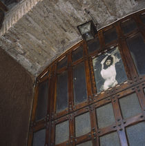 Low angle view of a lantern hanging on a doorway, Rome, Italy by Panoramic Images