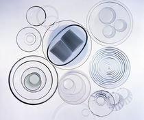Arrangement of clear glass cups, plates, bowls and glasses with dark blue ribbon by Panoramic Images
