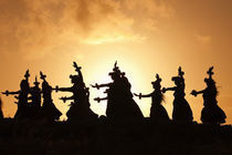 Silhouette of hula dancers at sunrise, Molokai, Hawaii, USA by Panoramic Images
