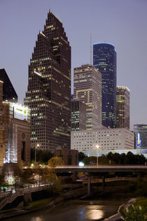 Buildings lit up at night, Wortham Theater Center, Houston, Texas, USA by Panoramic Images