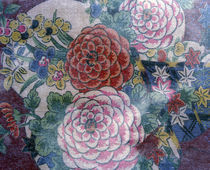 Close up of oriental chrysanthemum pattered fabric on dark blue background von Panoramic Images