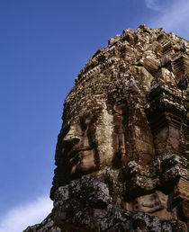 Low angle view of a face carving, Angkor Wat, Cambodia by Panoramic Images