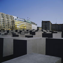 Memorial in front of buildings by Panoramic Images