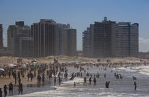 Tourists enjoying on the beach by Panoramic Images