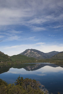 Reflection of mountains in a lake by Panoramic Images