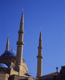 Low angle view of a church and a mosque by Panoramic Images