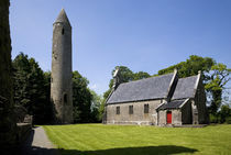 7Th Century Timahoe Church and 12th Century Round Tower by Panoramic Images