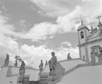 Low angle view of statues in front of a church von Panoramic Images